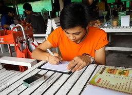สงขลาเด็กเสริฟลาวเขียนภาษาไทยแบบแนวตั้ง