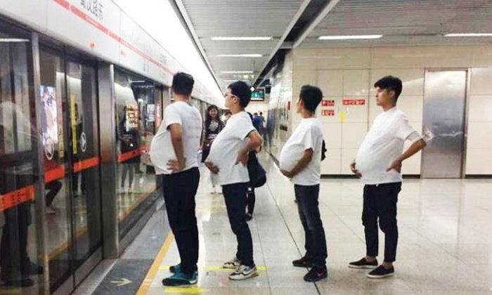 คุณพ่อจีนลงทุน(แกล้ง)ท้อง เรียกร้องสิทธิให้หญิงอุ้มท้องบนรถไฟใต้ดิน