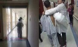 ชาวเน็ตชื่นชม! หมอหนุ่มจีนคว้าตัวคนไข้คลั่งมากอดไว้จนสงบ